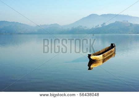 Charming Landscape With Lonely Wooden Boat (dug-out Canoe ) On Lake