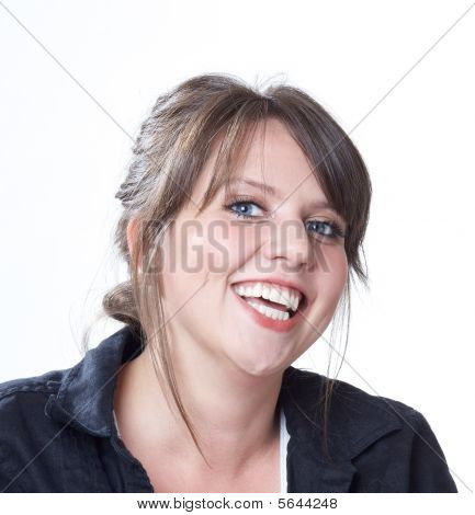 Happy and laughing young woman; head and shoulders shot