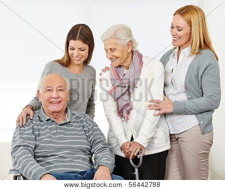 Three generations with happy senior couple at home