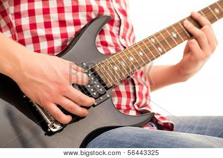 Music, close-up. Musician with electro guitar