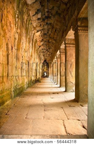 Ancient stone passage of Prasat Ta Prum or Ta Prohm Temple complex, near Siem Reap, Cambodia.