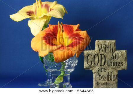 spiritual saying on a cross with flowers