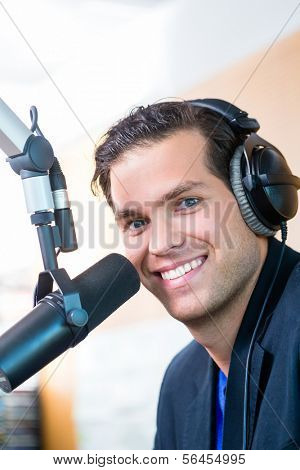 Presenter or host in radio station hosting show for radio live in Studio