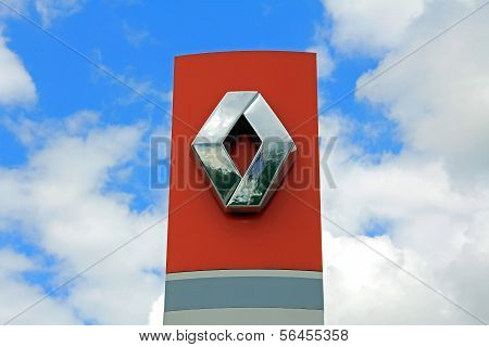 Sign Renault Against Blue Sky With Clouds