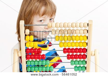 Boy Looking At Colorful Wooden Abacus Thinking