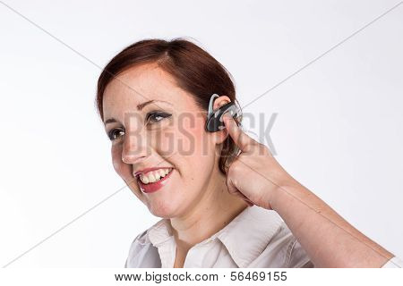 Smiling Woman with Bluetooth Earpiece