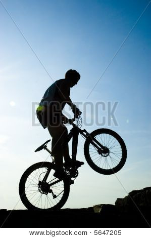 Silhouette Of A Man On The Bike