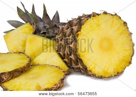 Pineapple And Slices Of Pineapple On A White Background.