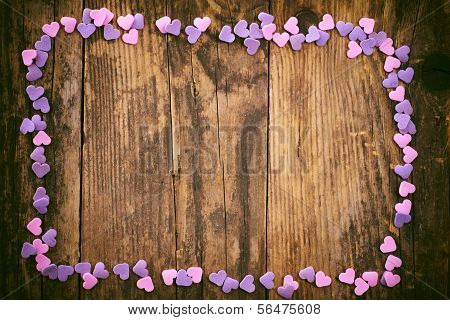 Wooden Slats Are Framed By The Small Hearts.