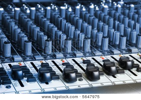 Closeup Of An Audio Mixing Board
