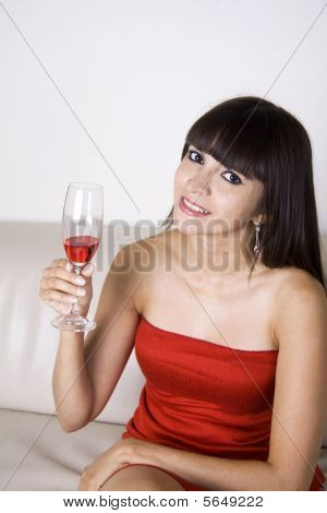 Woman Having A Drink At A Party