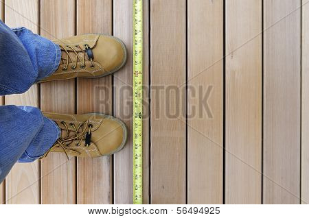 Looking Down at Worker and Tape Measure