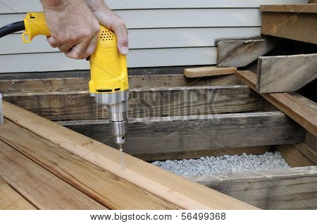 Worker Using Electric Drill