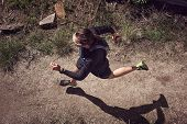 overhead view of trail runner running on mountain