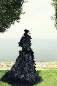 picture of evil queen  - Fashion woman posing near the sea - JPG