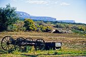 stock photo of covered wagon  - new mexico landscape with ruins of an old covered wagon - JPG
