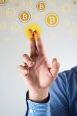 foto of bitcoin  - Collecting bitcoins businessman pressing bitcoin icon - JPG