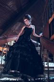 foto of gothic female  - Mysterious woman dressed in gothic dress posing in ruined building - JPG