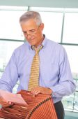 Middle Aged Businessman With File Box