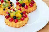 stock photo of custard  - Sponge cake flan filled with forest fruits kiwi and custard - JPG