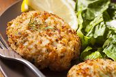 stock photo of cooked crab  - Organic Homemade Crab Cakes with Lemon and Tartar Sauce