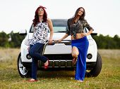Beautiful Ladies Sitting On A Car