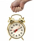 Man's Hand In A Fist About To Hit A Gold Clock