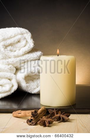 Spa Massage Border Background With Towel Stacked And Candle With Spices And Cinnamon Flavor