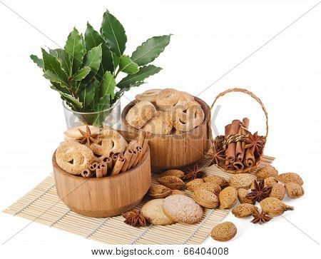 Sweet Sugar Cookies In Wooden Containers With Cinnamon Sticks, Almonds, Anise Asterisks, And A Sprig