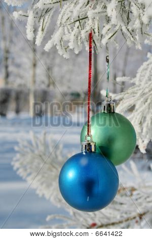 Two Balls On Branch On Snow Background (vertical Orientation)