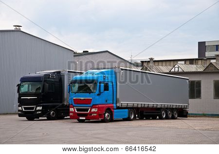 Trucks in a loading area of a factory