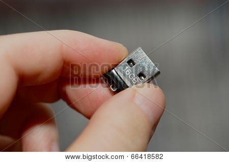 Tiny USB drive being held