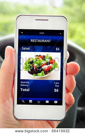Hand Holding Mobile Phone With Restaurant Order Screen