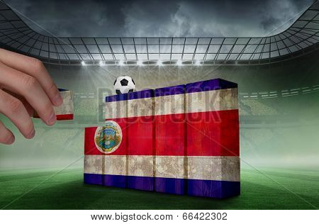 Hand building wall of costa rica flag in grunge effect