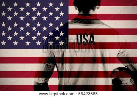 Composite image of usa football player holding ball against usa national flag