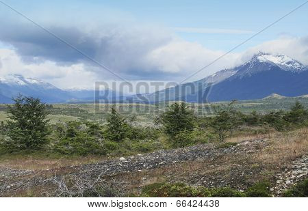 Patagonian Landscape With Mountains And Clouds