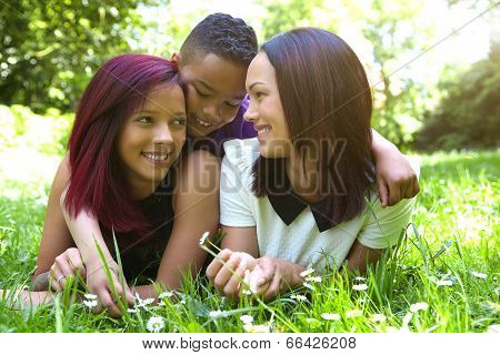 Two Females Smiling With Little Boy