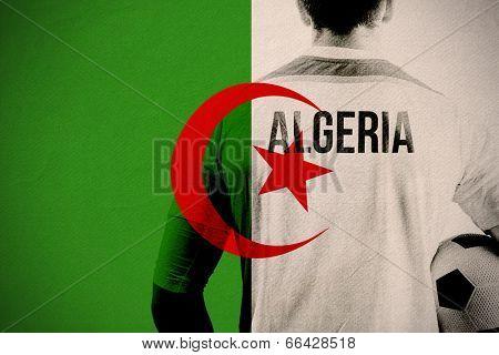 Algeria football player holding ball against algeria national flag