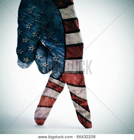 a man hand with its fingers painted as american flag simulating someone walking