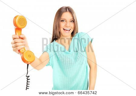 Beautiful young woman holding a telephone isolated on white background