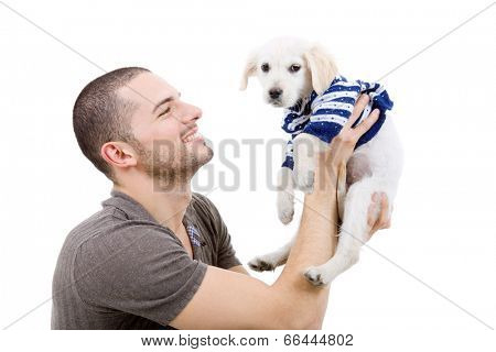 young man holding a cute small dog isolated on white
