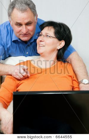 Senior couple surfing Internet