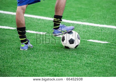 Soccer Player's Feet Stepping Onto A Soccer Ball
