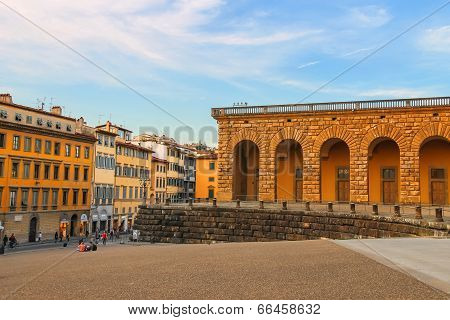 Tourists On A Sloping Square Before The Palace Pitti In Evening  Florence, Italy