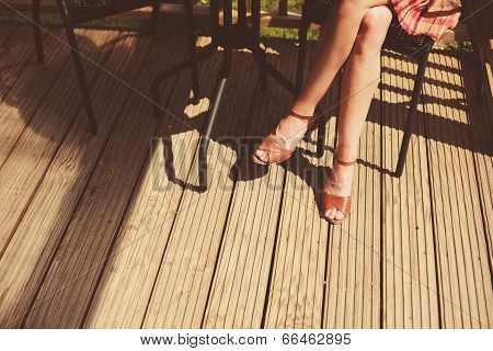 Young Woman Relaxing On Porch