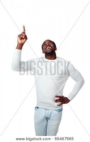 Laughing african man pointing up on white background
