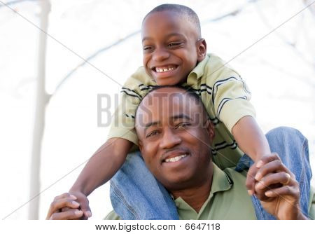 African American Man And Child Having Fun