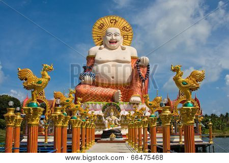 Smiling Buddha Of Wealth Statue On Koh Samui, Thailand