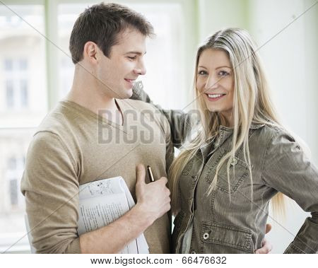 Loving business couple in office