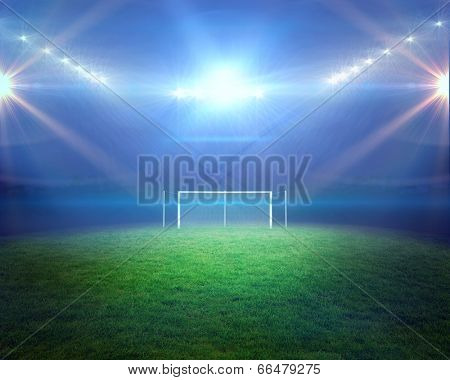 Digitally generated football pitch with lights and goalpost